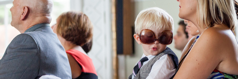 Boy at a wedding in sunglasses