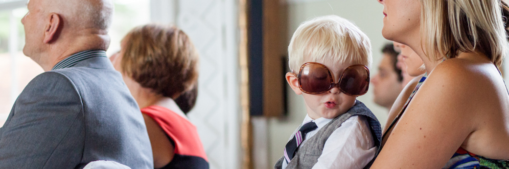 Boy at a wedding in sunglasses
