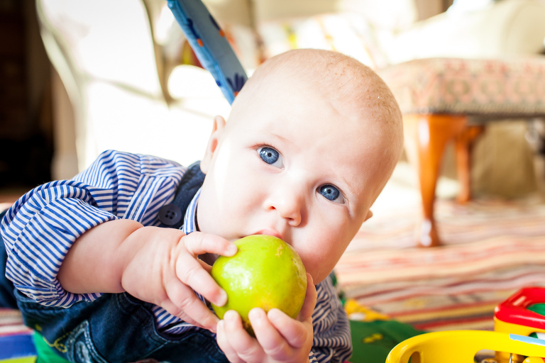 Little boy eating a whole lime