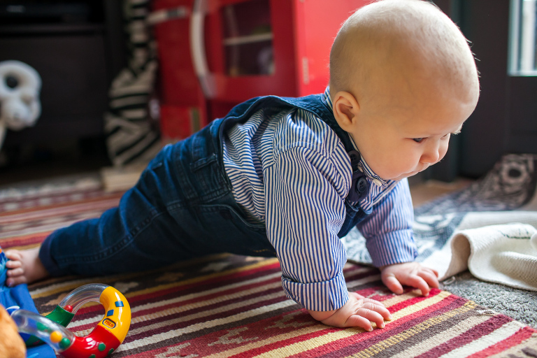 Little boy learning to crawl