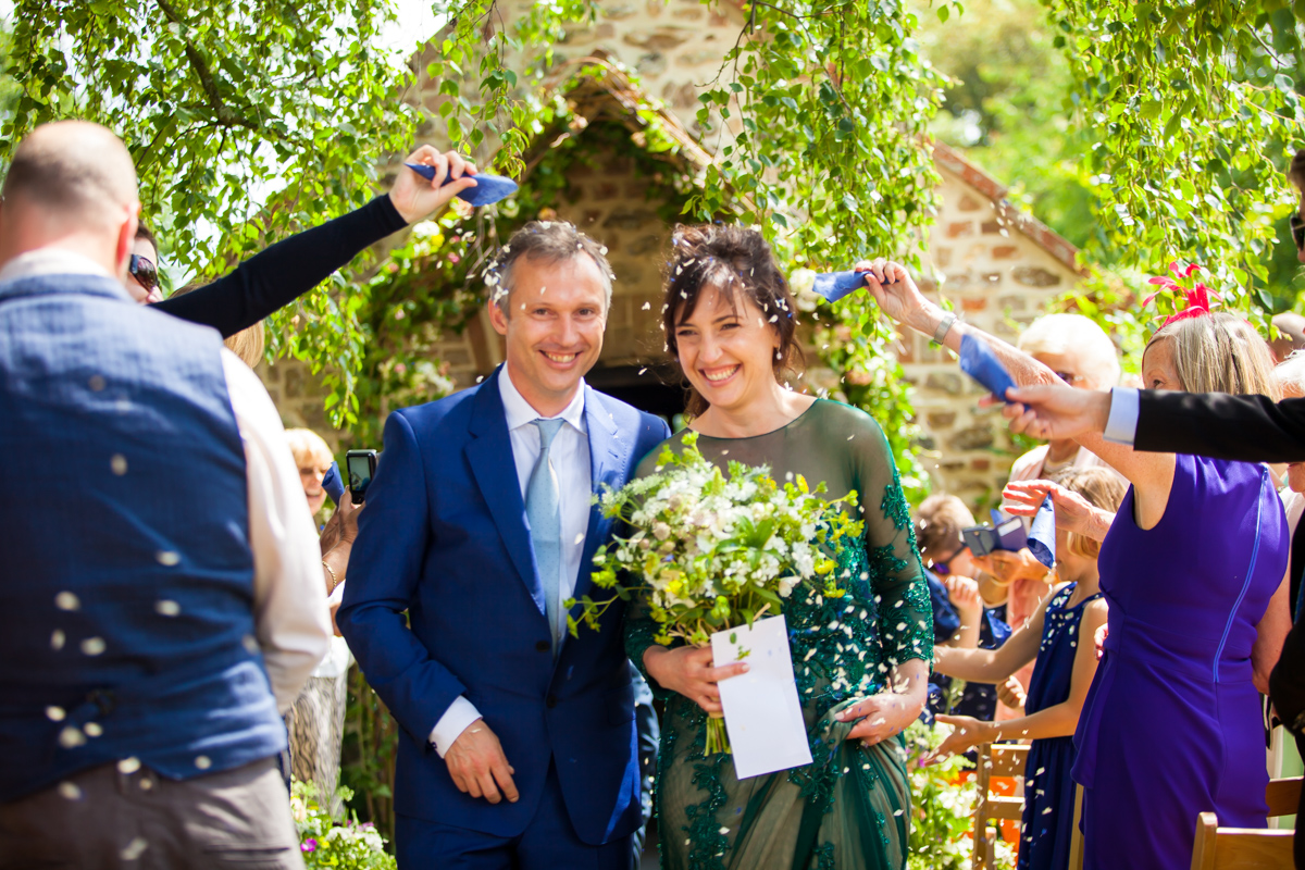 confetti shot of couple at cadhay house